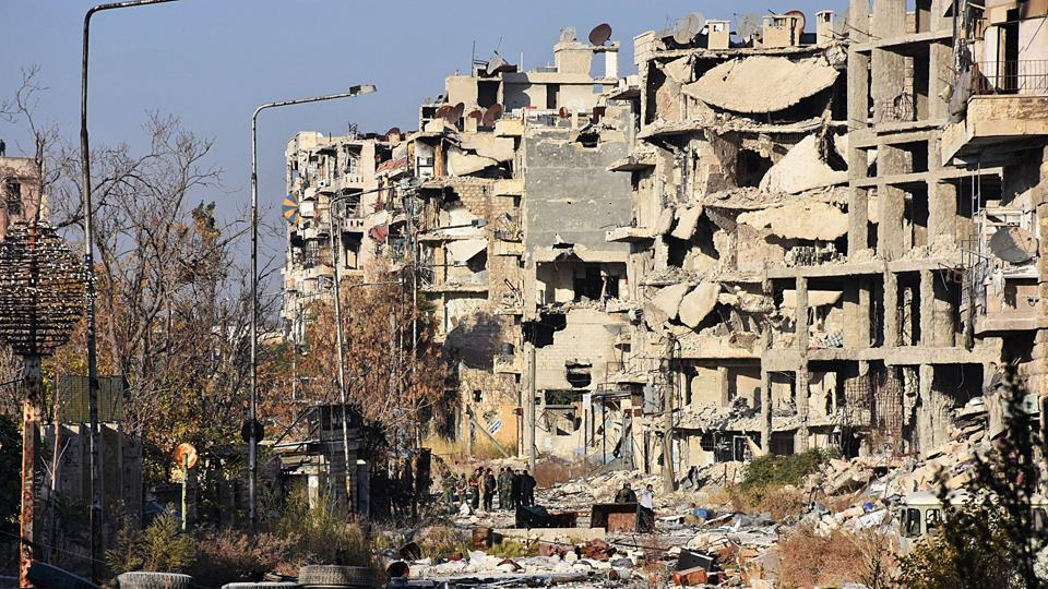 Destruction is seen in Aleppo's Bustan al-Basha neighbourhood on November 28, 2016, during Syrian pro-government forces assault to retake the entire northern city from rebel fighters. Government forces have retaken a third of rebel-held territory in Aleppo, forcing nearly 10,000 civilians to flee as they pressed their offensive to retake Syria's second city. In a major breakthrough in the push to retake the whole city, regime forces captured six rebel-held districts of eastern Aleppo over the weekend, including Masaken Hanano, the biggest of those in eastern Aleppo. / AFP PHOTO / GEORGE OURFALIAN (AFP)