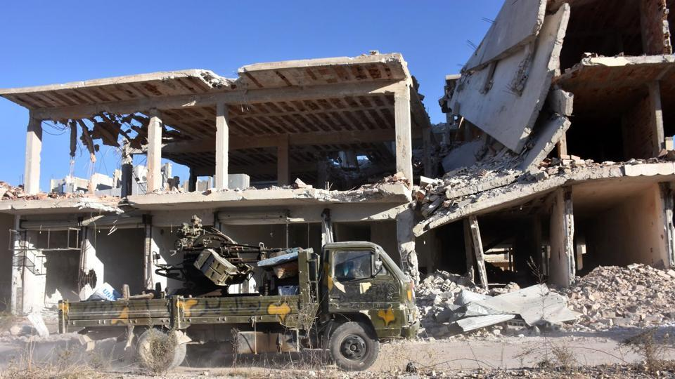 A vehicle of Syrian pro-government forces drives past damaged buildings on November 27, 2016 in the Masaken Hanano district in eastern Aleppo, a day after they resized it from rebel fighters. Syria regime forces seized two new rebel-held districts in Aleppo a day after they retook the largest opposition-controlled neighbourhood in the second city, a monitor said. The capture of Masaken Hanano -- which had been the biggest rebel-held district of Aleppo -- was a major breakthrough in a 13-day regime offensive to retake the entire city.  (AFP)