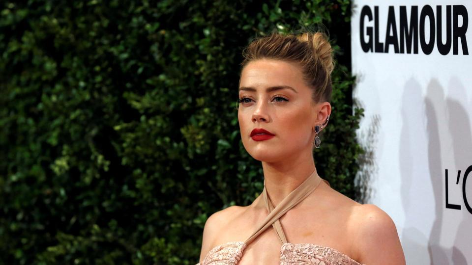 Actor Amber Heard poses at the Glamour Women of the Year Awards in Los Angeles.
