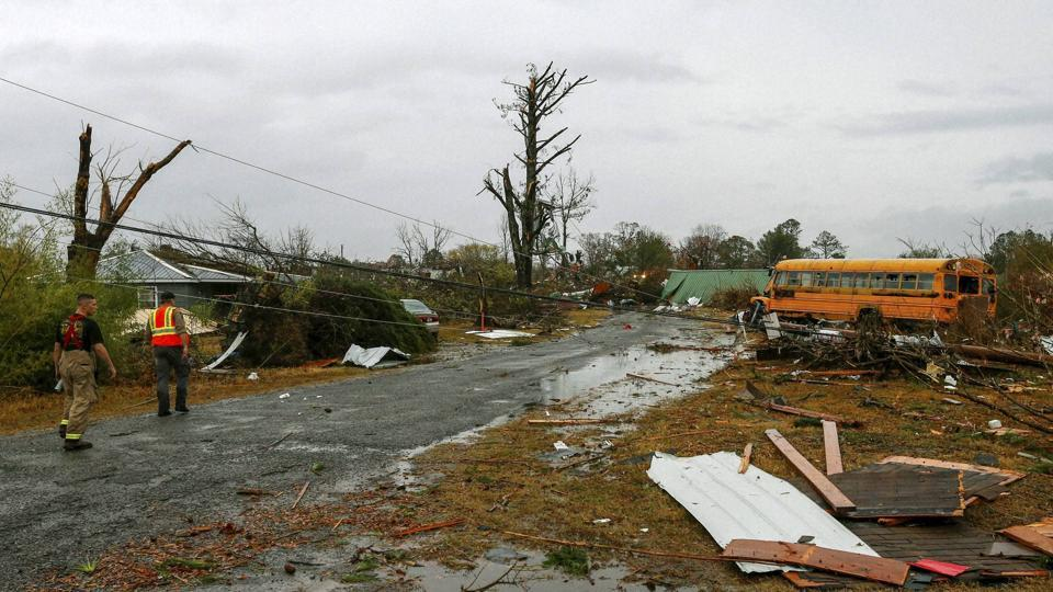 The National Weather Service fielded more than two dozen reports of tornados as the storm system, packing hail and heavy downpours, moved through eastern Texas, northern Mississippi and Alabama and into southeast Tennessee late on Tuesday and early on Wednesday morning.