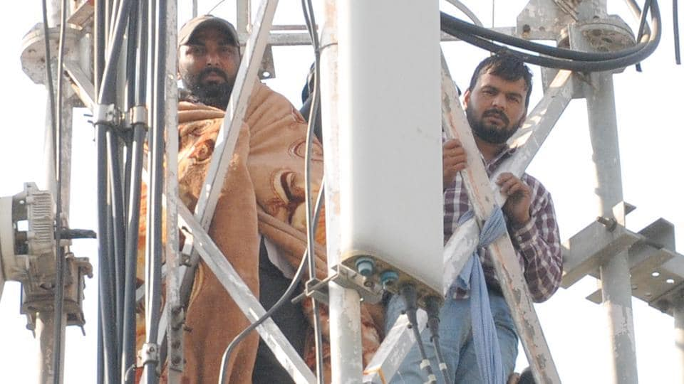 Members of the unemployed ETT-pass teachers' union of Punjab atop mobile tower near the chief minister residence in Sector 3, Chandigarh.