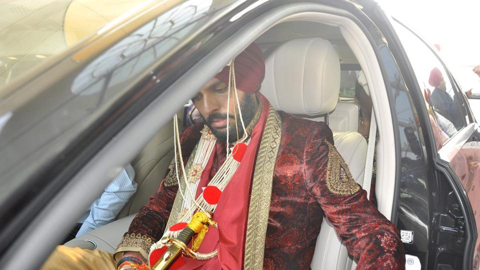 Yuvi wore a lush red sherwani with golder salwar and red pagdi. (Sant Arora/ HT Photo)