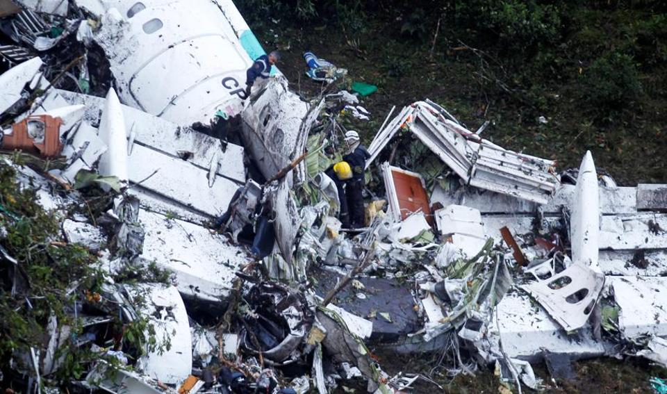 Rescue crew work at the wreckage from a plane that crashed into Colombian jungle with Brazilian soccer team Chapecoense near Medellin, Colombia.