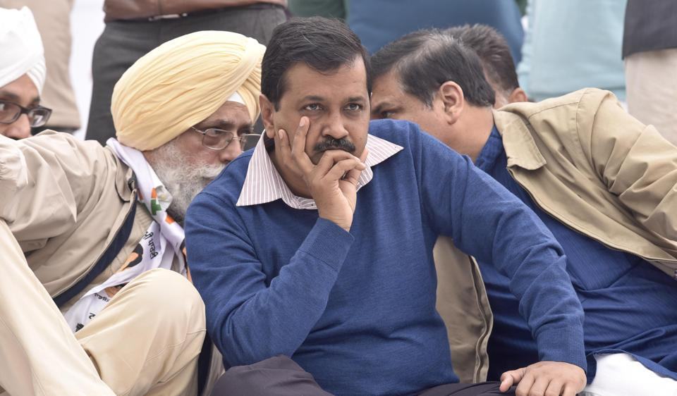 AAP convener Arvind Kejriwal at a rally stage in Amritsar as (left) party candidate Inderbir Singh Nijjer has a word with state in-charge Sanjay Singh, on Wednesday, November 30.