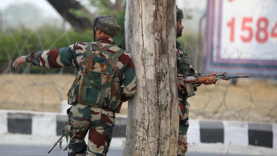 Indian Army soldiers take position during a gun battle with armed militants at an army base at Nagrota, some 15 km from Jammu, on Tuesday.
