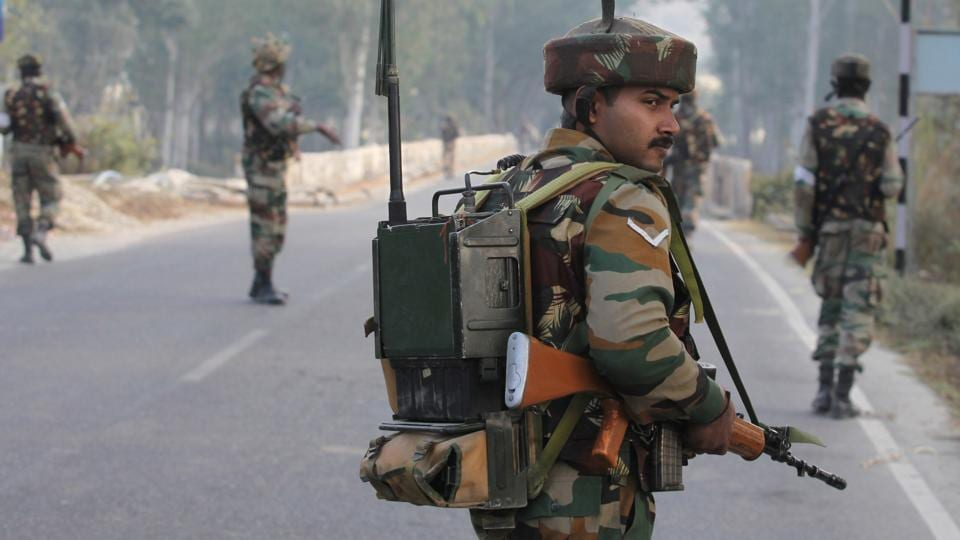 Soldiers patrol on the Jammu-Srinigar National Highway during a combing operation after a gun battle with armed militants at an army base at Nagrota, some 15 kms from Jammu on November 30, 2016.