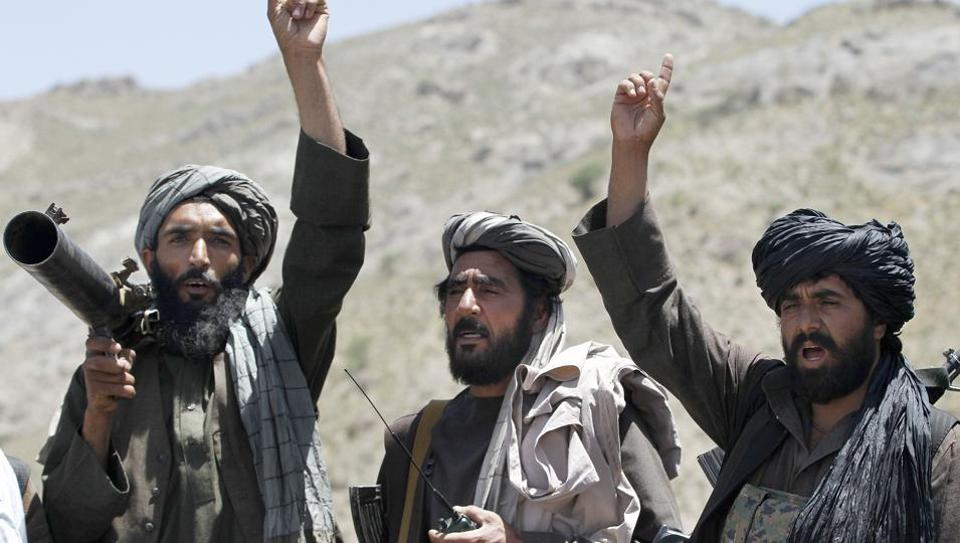 Taliban fighters react to a speech by their senior leader in the Shindand district of Herat province, Afghanistan, in May 2016.