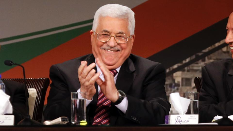 Palestinian president Mahmud Abbas (C) looks on during the opening ceremony of the 7th Fatah Congress on November 29, 2016, at the Muqataa, the Palestinian Authority headquarters, in the West Bank city of Ramallah.