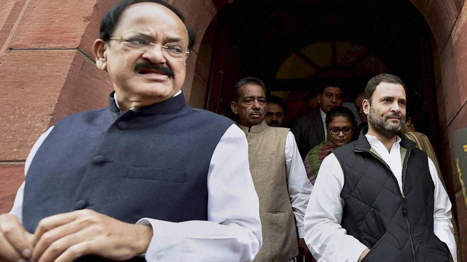 Congress vice-president Rahul Gandhi and I&B minister M Venkaiah Naidu come out of the Parliament House in New Delhi.