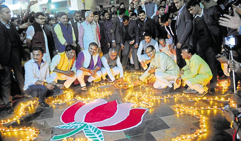 Chief minister Shivraj Singh Chouhan, along with state BJP president Nandkumar Singh Chauhan, lights earthen lamps during a programme organised by the Bharatiya Yuva Morcha in Bhopal on Tuesday to mark the CM's 11 years in office.