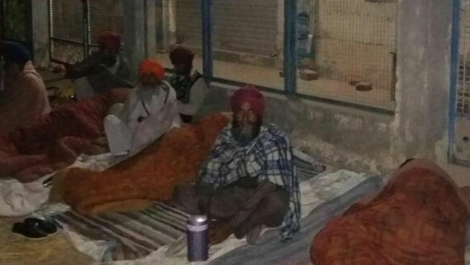 Residents of Sangrur's Hathan village sleeping in front of the local bank branch on Wednesday night.