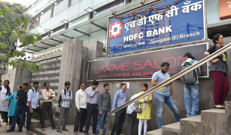 People queue up outside HDFC bank in Goregaon (East) on Thursday.