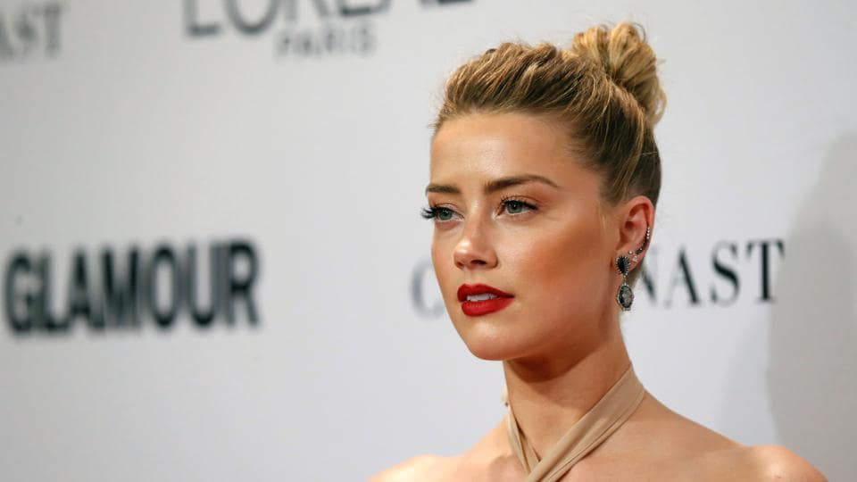 Actor Amber Heard poses at the Glamour Women of the Year Awards in Los Angeles, California.