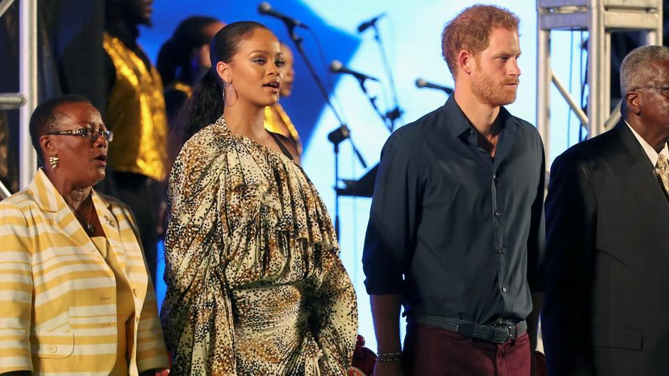 Barbadian Prime Minister Freundel Stuart (R), Britain's Prince Harry (C) and singer Rihanna stand for the national anthem ahead of a concert in Bridgetown to commemorate the 50th independence anniversary of Barbados November 30, 2016. REUTERS/Adrees Latif