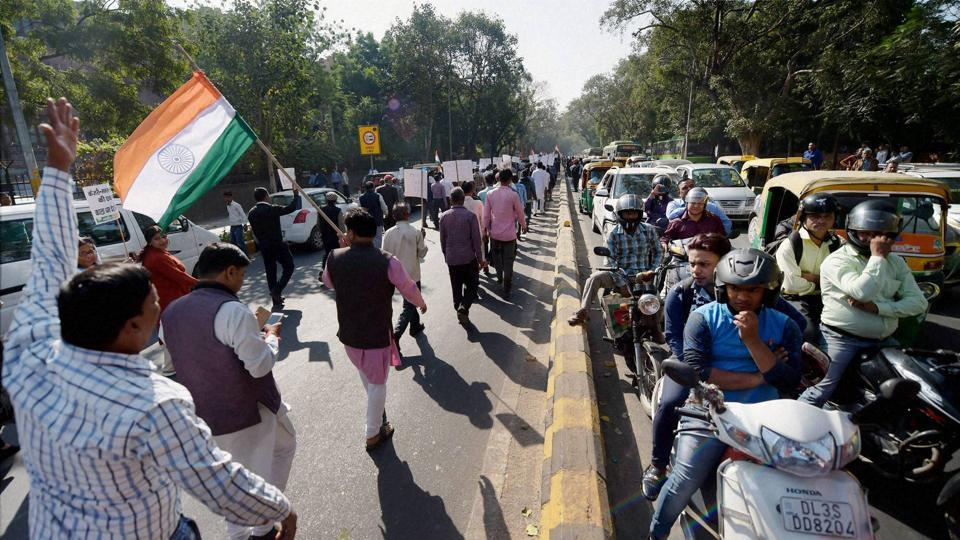 BJP leaders take out a march against black money and corruption in New Delhi on Friday.