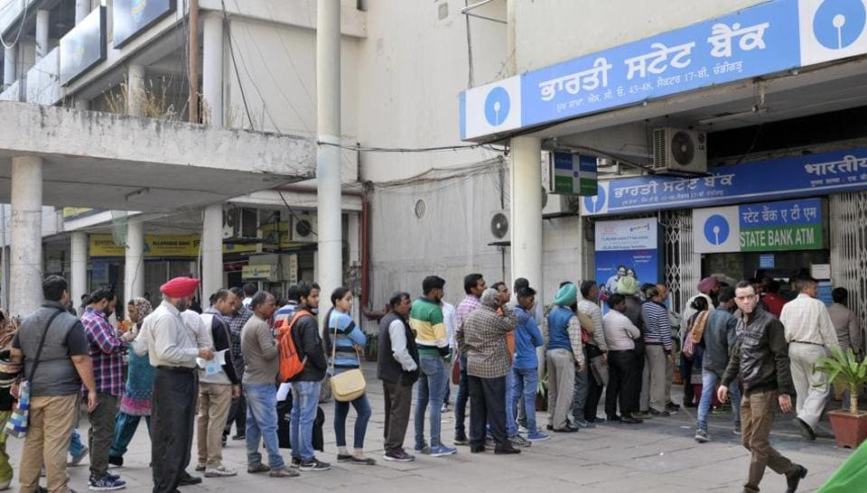 A long queue outside a State Bank of India ATM at the Bank Square in Sector 17, Chandigarh, on Wednesday.