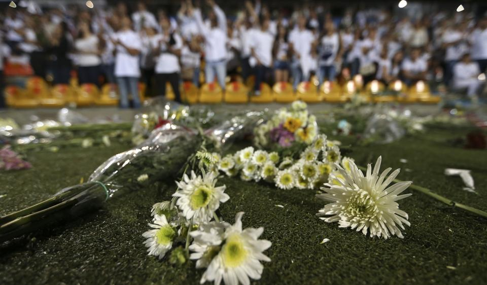 Flowers lay on the field after a tribute to members of Brazil's Chapecoense soccer team who died in a plane crash, at Atanasio Girardot stadium where they were to play a game in Colombia.  (Fernando Vergara/AP)
