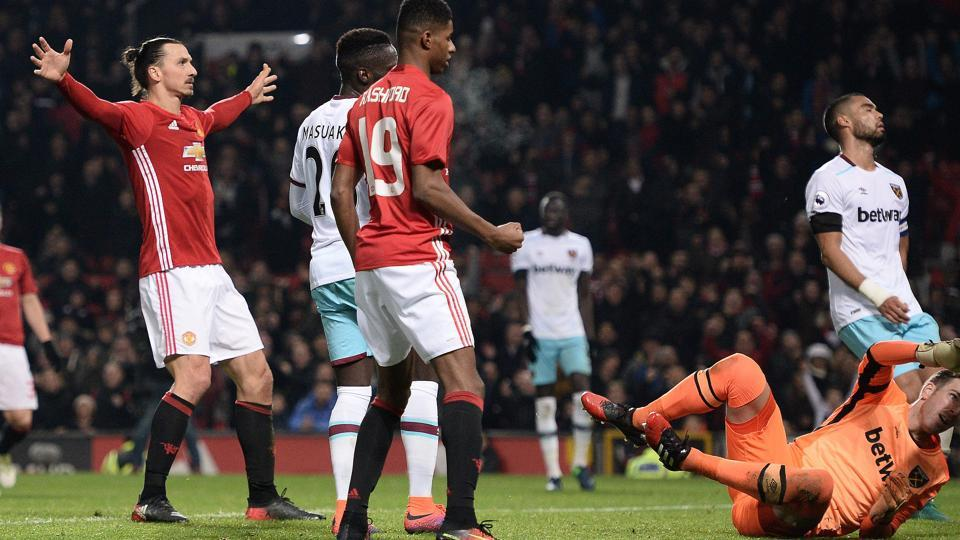 Manchester United's Swedish striker Zlatan Ibrahimovic (left) celebrates after scoring his team's fourth goal during the English Football League Cup quarterfinal match against West Ham United at Old Trafford.