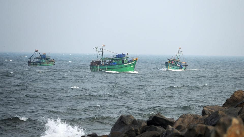 Indian fishermen return to harbour in Chennai as tropical cyclone 'Nada' is forecast to make landfall on the southern coast of India, on early December 1
