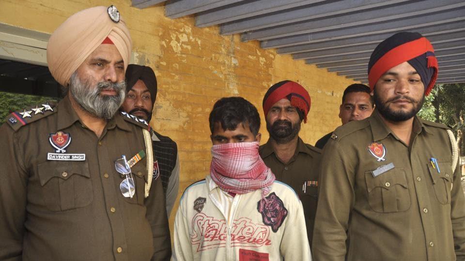 The accused hoax caller in police custody in Jalandhar on Wednesday November 30, 2016.