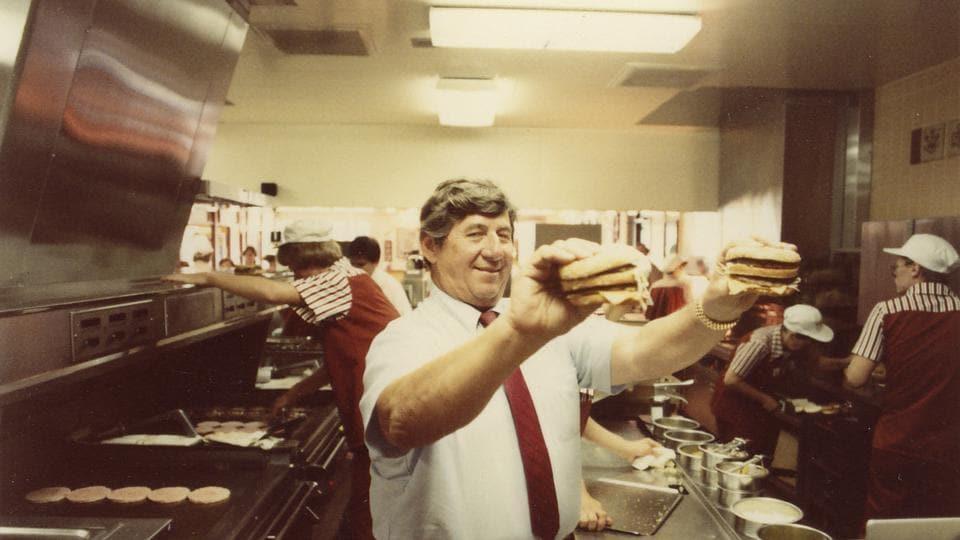 In an undated handout photo, Jim Delligatti holds two Big Mac burgers.