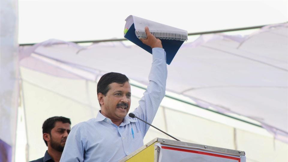 """""""I will go around the country with these papers and expose the BJP,"""" Kejriwal said, waving a set of documents containing allegations against the Prime Minister at a rally against demonetisation of currency notes, at Meerut on Thursday."""