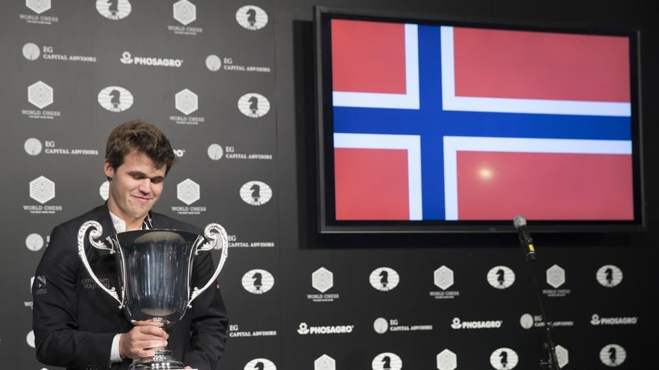 Magnus Carlsen, of Norway, smiles as he looks at his championship trophy during the award ceremony for the World Chess Championship.