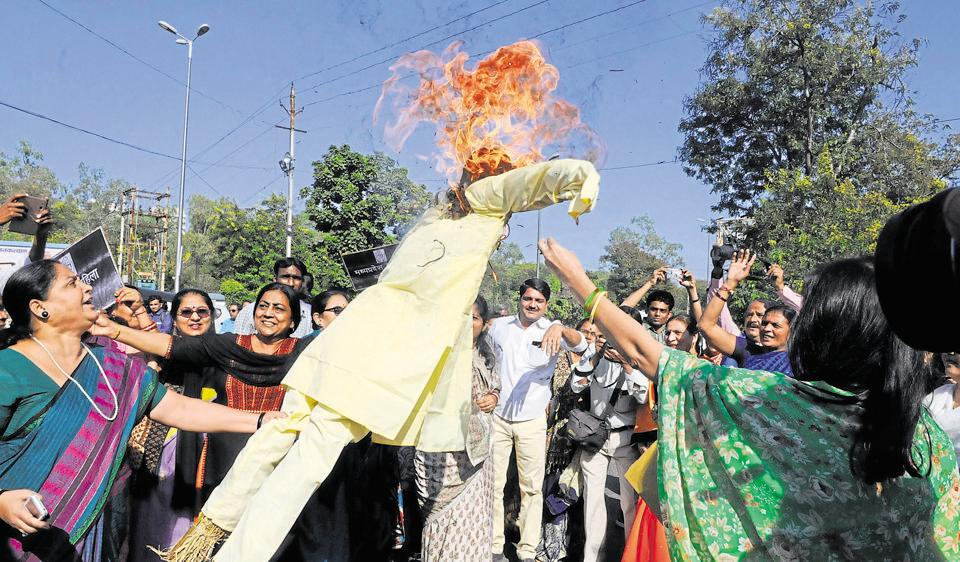 MP Mahila Congress workers burn an effigy of Prime Minister Narendra Modi to protest against demonetisation in Bhopal on Wednesday.