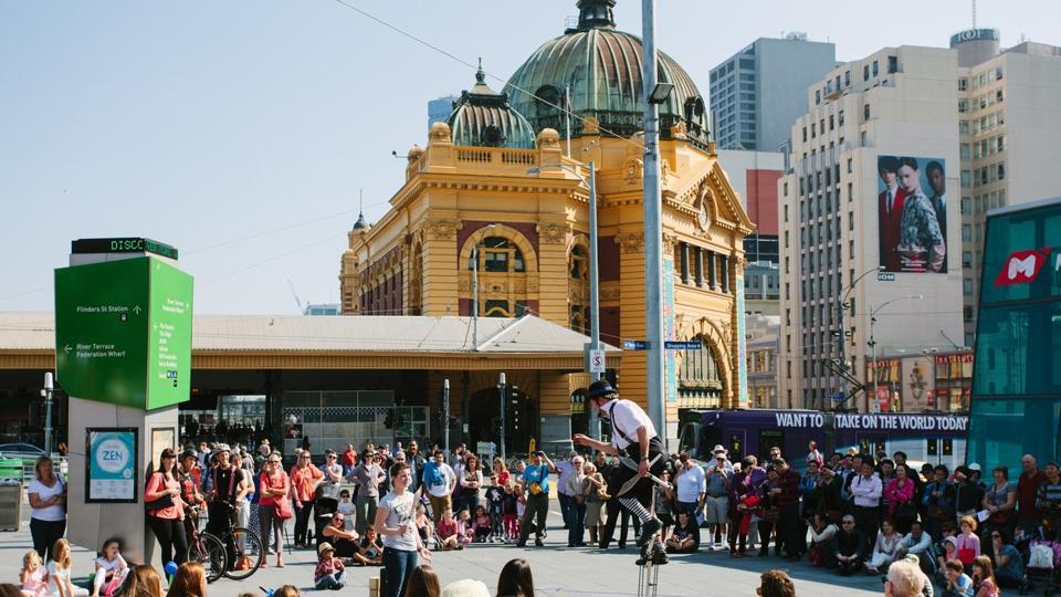 Melbourne in Australia came second. Seen here are street performers in Federation Square in the city. (AFP)