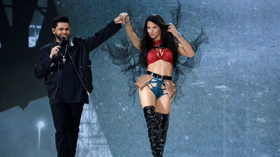 Musician The Weeknd performs with model Adriana Lima. (REUTERS)