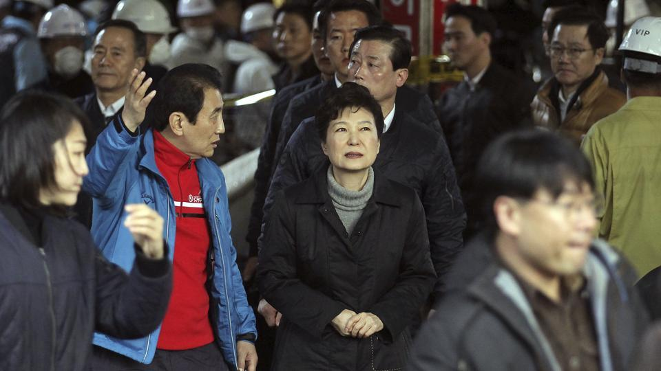 South Korean President Park Geun-hye, center, is escorted by Seomun Market Merchant Association President Kim Yong-oh, second left, during her visit to the Seomun Market which was burned by a recent fire in Daegu.