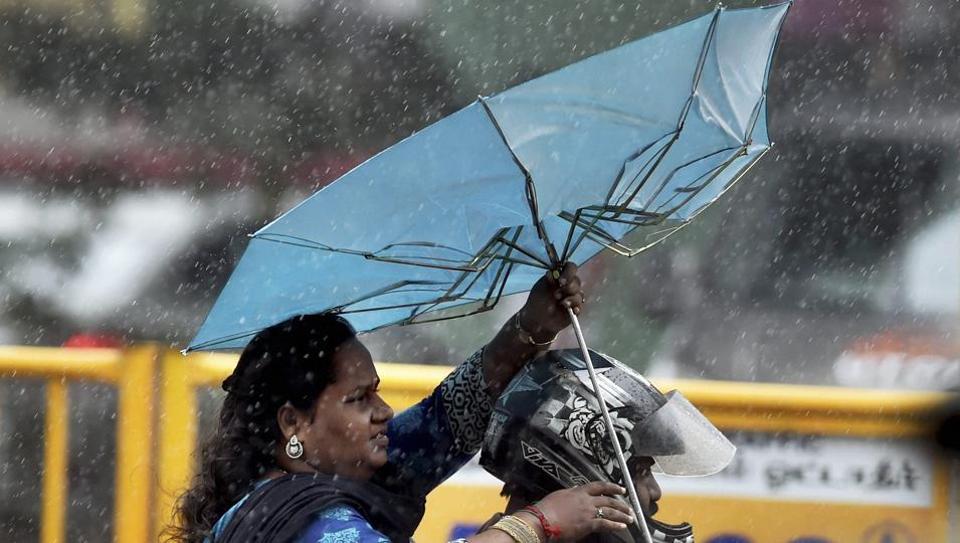 A motorcyclist rides through heavy rains in Chennai on Thursday.