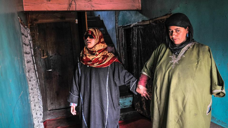 15-year-old Insha Mushtaq, who was blinded in both eyes by pellets, with her mother in Sedow village in south Kashmir's Shopian district.