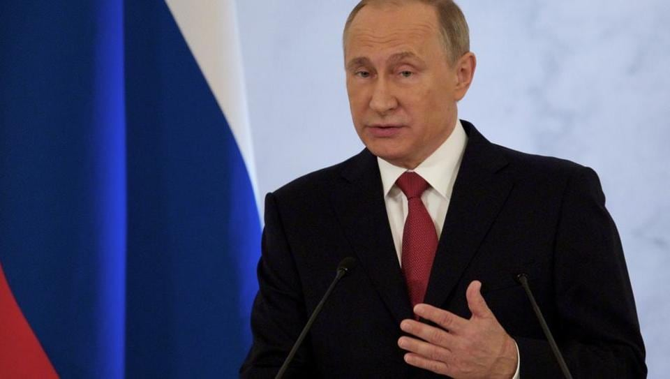 Russian President Vladimir Putin gestures as he gives his annual state of the nation address in the Kremlin in Moscow.