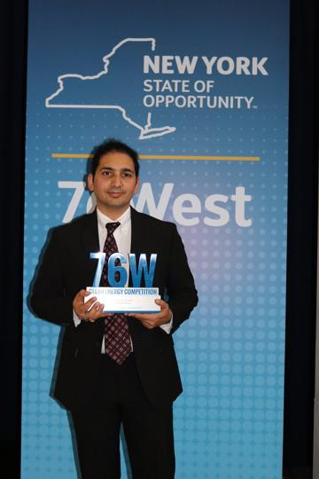 Shailesh Upreti with the 76West Clean Energy Competition award in New York.