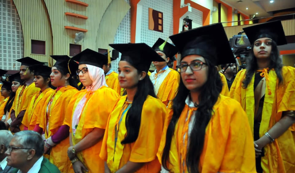 The governor gave medals to students who had received Ph.d degrees and secured top ranks in various subjects.