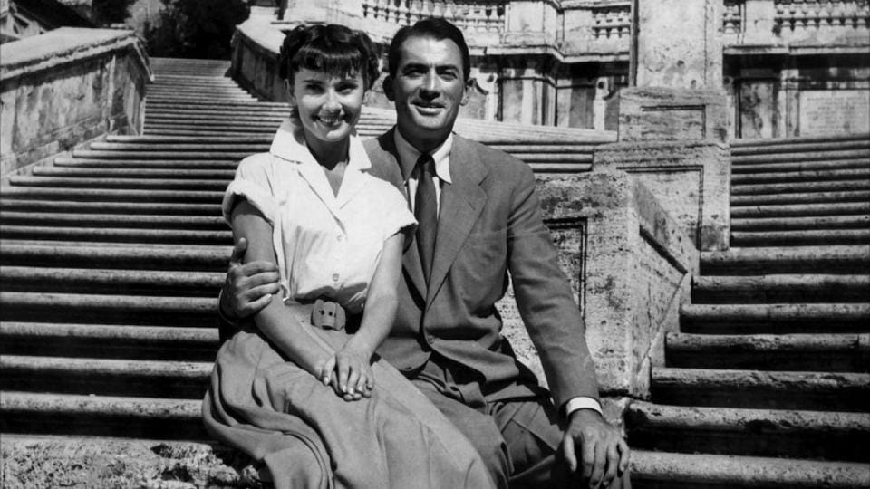 Actors Audrey Hepburn and Gregory Peck in a still from Roman Holiday (1953).