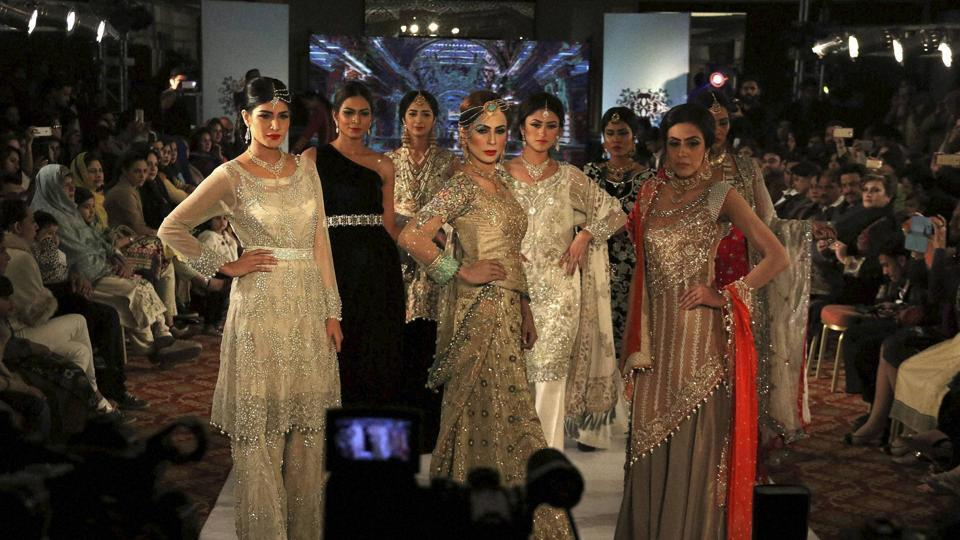 Models present creations by local designers of label Nauratan during a fashion show in Peshawar, Pakistan. (AP)