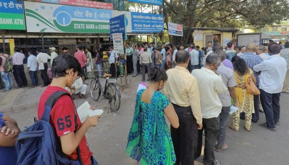 Thane residents standing in queues outside SBI Bank on Friday.