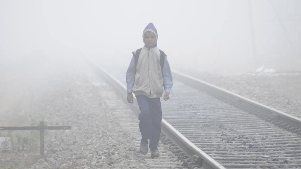 Unmindful of the danger, a school student walks next to railway tracks in Baradari area of in Patiala on Friday. (Bharat Bhushan/HT)