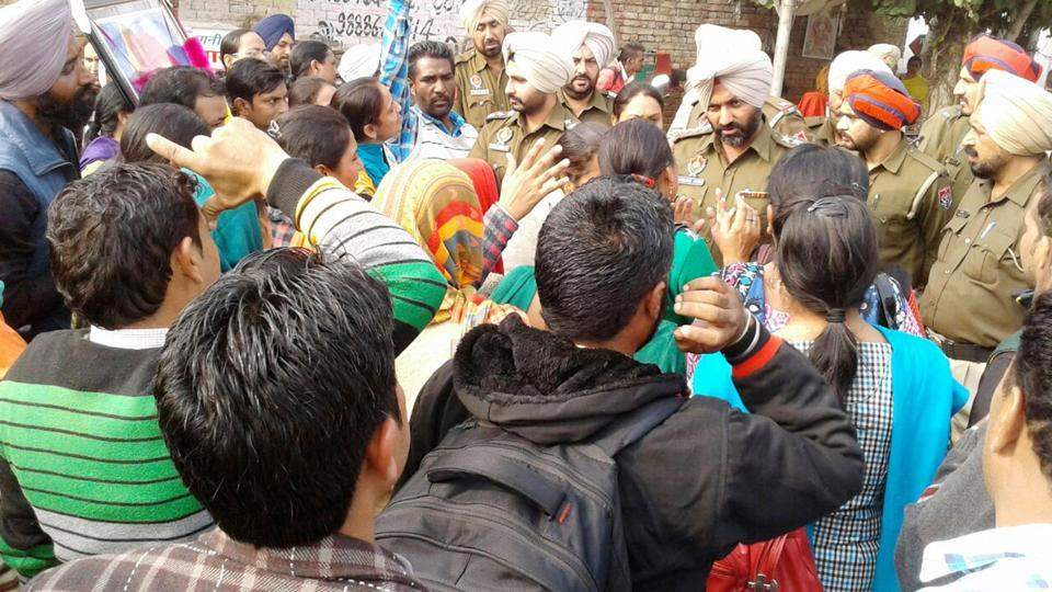 Members of the teachers' union being stopped from marching towards MLA Sarup Chand Singla's house in Bathinda on Thursday.