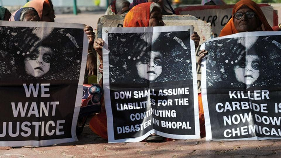 Bhopal gas disaster survivors hold posters during a protest rally in Bhopal.