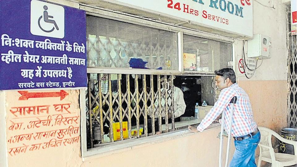A differently-abled man stands at the enquiry section at Sarwate bus stand in Indore.