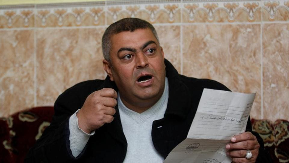 Abdel Razzaq Jalal, who was detained by the Islamic State speaks during an interview with Reuters in Fadiliyah, Iraq.