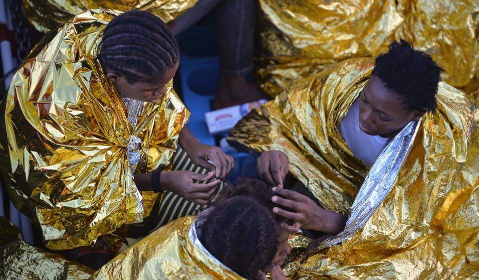 This photo taken on November 3 shows African women aboard the Topaz Responder ship run by Maltese NGO Moas and the Red Cross after a rescue operation of migrants and refugees, off the Libyan coast in the Mediterranean Sea. Many of them are destined for years of sexual slavery