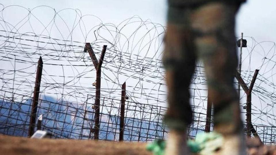 An Indian army soldier patrols near the line of control, after a reported cease-fire violation, in Mendhar, Poonch district, about 210 kilometers from Jammu.