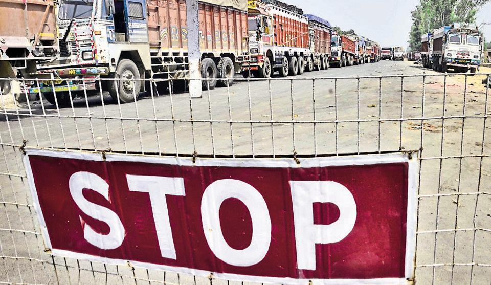 Trucks line up on roads as Indo-Pak trade slows at the Attari Border road near the integrated check post in Amritsar on September 10, 2016.