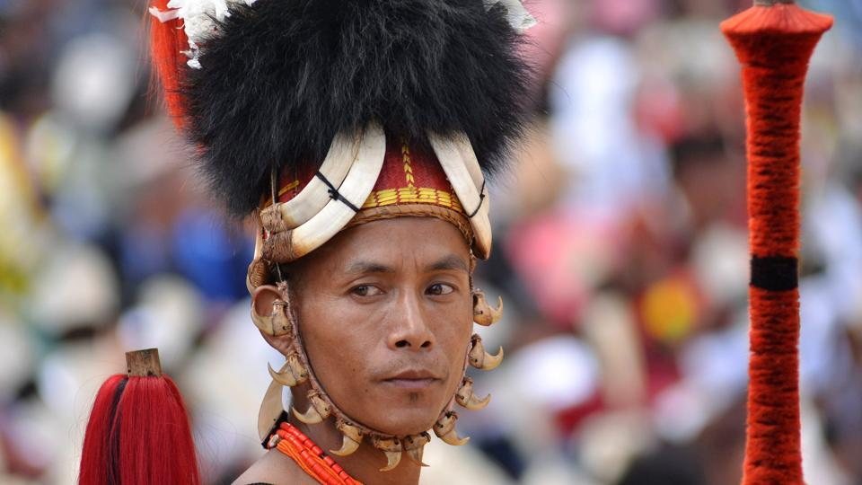 A Naga tribesman waits to perform a cultural dance at the opening day of the annual Hornbill Festival in Nagaland on Thursday. (PTI)