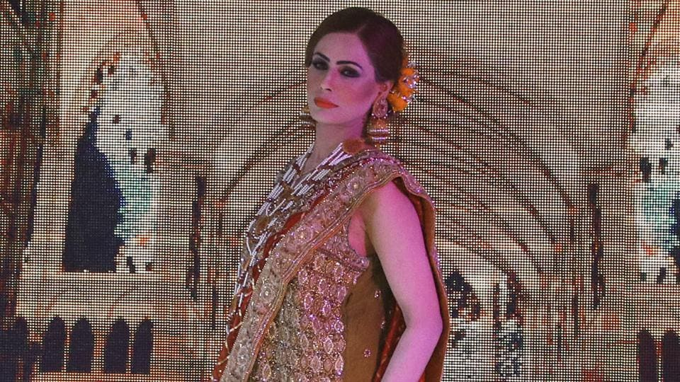A model presents a creation by local designers of label Nauratan during a fashion show in Peshawar, Pakistan. (AP)