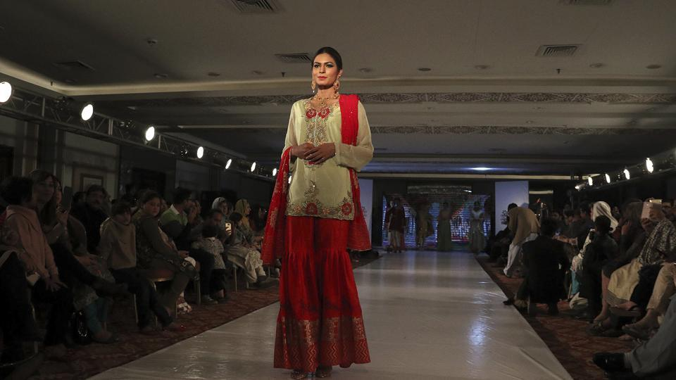 A Model walks the ramp in Peshawar during a fashion show by local designers of label Nauratan. (AP)
